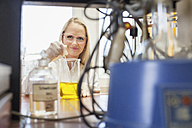 Portrait of female scientist in chemical laboratory - NAF000007