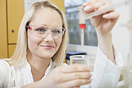 Portrait of female scientist in chemical laboratory - NAF000009