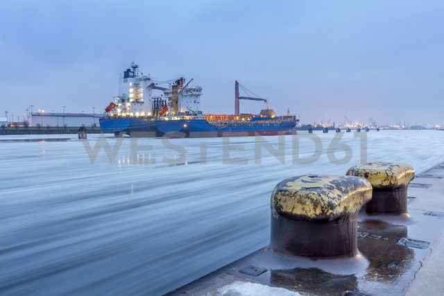 Germany, Hamburg, Port of Hamburg, Two small container ships during heavy ice drift on the elbe river - NK000078