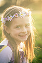 Portrait of smiling little girl wearing flowers - SARF000428