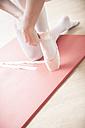 Ballet dancer putting on toe shoes - VTF000191