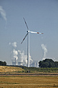 Germany, North Rhine-Westphalia, Wind turbine in front of brown coal power station - RDF001257