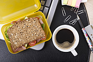 Workplace with lunchbox and cup of coffee - CSTF000214
