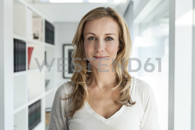 Portrait of woman in her bright modern home - MFF000989