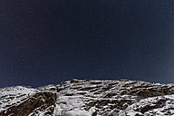 Norway, Starry sky over mountain near Kirkenes - SR000500