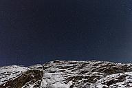 Norway, Starry sky over mountain near Kirkenes - SR000500