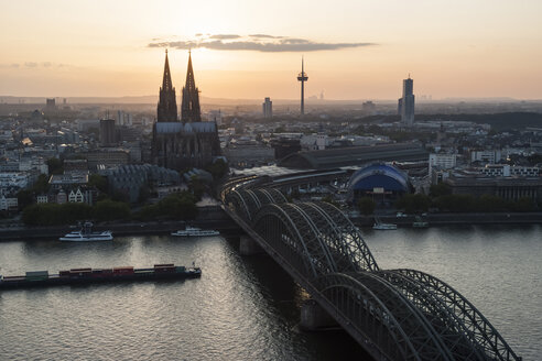 Germany, North Rhine-Westphalia, Cologne, city view with Cologne Cathedral and Colonius at evening twilight - PAF000584