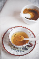 Cup of turmeric tea spiced with pepper - SBDF000749