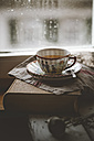 Cup of Chinese green jasmin tea on book - SBDF000761