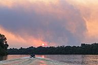 Brazil, Mato Grosso do Sul, Pantanal, Cuiaba River, Forest fire  at sunset - FOF006457