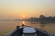 Brazil, Mato Grosso do Sul, Pantanal, Boat on Cuiaba River at sunrise - FOF006459