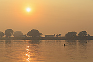 Brazil, Mato Grosso do Sul, Pantanal, Cuiaba River, Forest fire at sunrise - FO006460