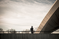 Germany, Berlin, female tourist standing on terrace of House of World Cultures looking at view - FBF000315