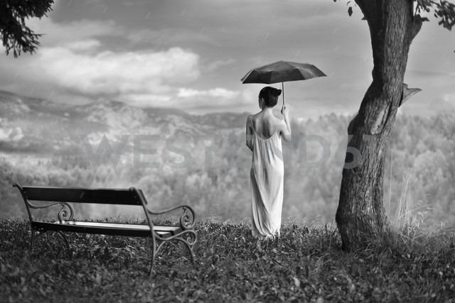 Woman with umbrella in nature - CvK000124