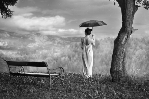 Woman with umbrella in nature - CvK000124