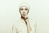 Portrait of a young woman wearing white wooly hat - CvK000143