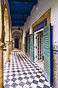 Morocco, Marrakesh-Tensift-El Haouz, painted doors and mosaic flooring of hotel - THA000220