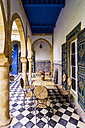 Morocco, Marrakesh-Tensift-El Haouz, table and chairs on mosaic flooring - THA000222