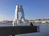 Germany, Berlin, Young man looking at Spree with molecule man - FBF000337