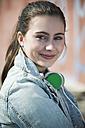 Portrait of smiling teenage girl with headphones - UUF000191