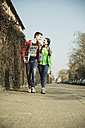 Teenage couple walking side by side - UUF000206