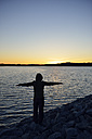 Sweden, Storuman, Man by the lakeside at sunset - BR000451