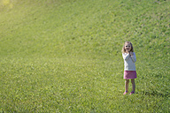 Little girl standing on meadow - MW000044