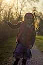 Portait of little girl standing at evening twilight - SARF000472