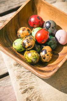 Germany, Colorful Easter eggs on wooden table - SARF000455