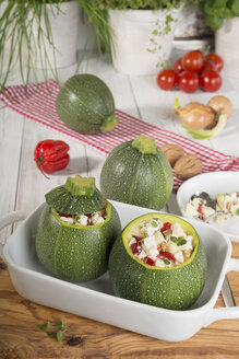Filled eight ball squashes with feta cheese and tomato in gratin dish, Low Carb - CSTF000239