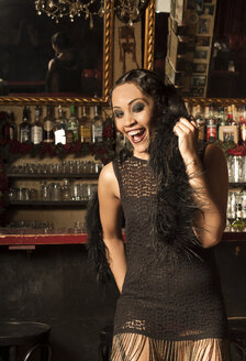 Young female Afro-American styled in the way of roaring Twenties in a bar - FC000150