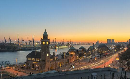 Germany, Hamburg, Port of Hamburg and Landungsbruecken at sunset - RJF000083