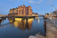 Germany, Hamburg, View of the International Maritime Museum at the Brooktorhafen after sunset - RJF000086