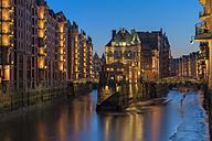 Germany, Hamburg, Speicherstadt after sunset, view in the Wandrahmsfleet - RJF000089