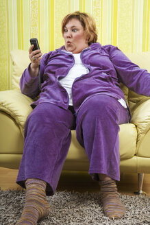 Germany, Mid-adult woman using mobile phone - ECF000582