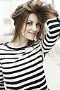 Portrait of woman with hand in her hair - GDF000305