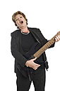 Portrait of woman playing guitar and singing - ECF000513