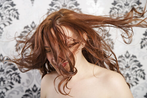 Young woman tossing hair - ECF000521