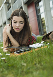 Young woman using digital tablet in meadow - UUF000293