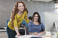 Portrait of two female colleagues in the office - RBF001614