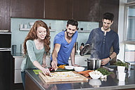 Portrait of three friends cooking together - RBF001677