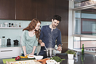 Portrait of young couple cooking together - RBF001679