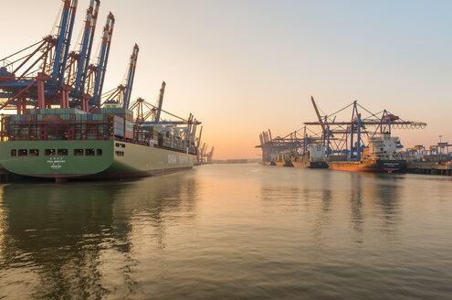 Germany, Hamburg, Port of Hamburg, Container Terminal Burchardkai in the evening - RJ000093