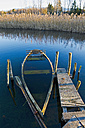 Germany, Bavaria, Upper Bavaria, Lake Staffelsee, sunken rowing boat at jetty - UMF000695