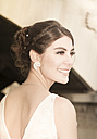 Portrait of young smiling bride with updo - FCF000028