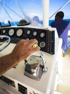 Caribbean, Lesser Antilles, Saint Lucia, hand on an engine control of a sailing boat - AM002157
