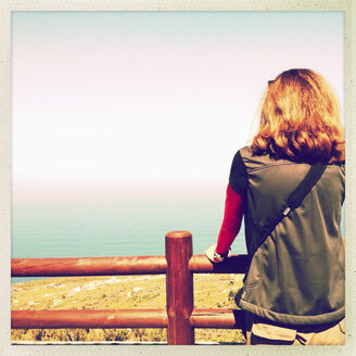 Woman on a railing overlooking the valley, Santa Domingo, La Palma, Spain - SEF000668