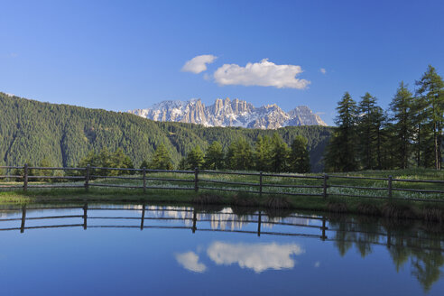 Italy, Trentino-Alto Adige, Dolomites, Latemar mountains reflecting in lake - RUEF001250
