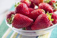 Glass bowl of strawberries on cloth - SARF000510