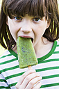 Portrait of girl with kiwi ice lolly - LVF001112